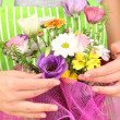 Stock Photo: Florist makes flowers bouquet