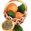 Passion fruits in wicker basket isolated on white — Stock Photo