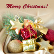 Beautiful Christmas decor on golden satin cloth — Stock Photo