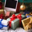 Gifts and Christmas decor with empty photo papers — Stock Photo
