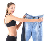 Slim girl with big jeans — Stock Photo