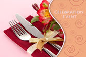 Festive dining table setting with flowers on pink background — Stock Photo