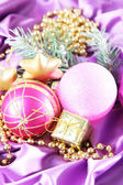 Beautiful Christmas decor on purple satin cloth — Stok fotoğraf