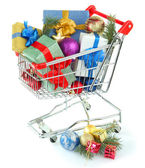 Christmas gifts in shopping trolley, isolated on white — Foto de Stock