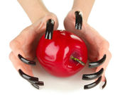 Hands with scary manicure holding red apple , isolated on white — Stockfoto