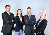 Group of business people on gray background — Foto Stock