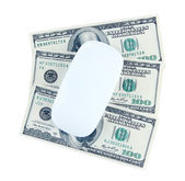 Computer mouse on dollars isolated on white — Stock Photo