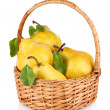 Juicy pears in wicker basket isolated on white — Stock Photo #33944183