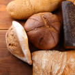 Much bread on wooden board — Stock Photo