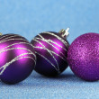 Christmas balls on blue background — Stock Photo #33944523