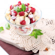 Fruit salad in glass bowl, isolated on white — Stock fotografie