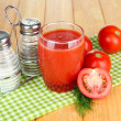 Tomato juice in glass, on wooden background — Stock Photo