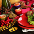 Table setting for Halloween with pumpkin and candles close-up — Stock Photo #33945919