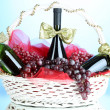 Gift basket with wine on blue background — Stock Photo #33947751