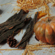 Stock Photo: Pumpkin with bark and bumps on wooden background