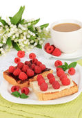 Delicious toast with raspberries on table close-up — Stock Photo