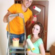 Young couple doing renovation in new house — Foto de Stock