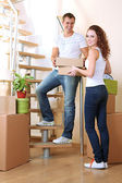 Young couple with boxes in new home on staircase — 图库照片