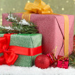 Beautiful bright gifts and christmas decor, on shiny background — Stock Photo