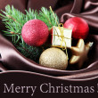 Beautiful Christmas decor on brown satin cloth — Stock Photo