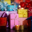 Many gifts on bright background — Stock Photo #34100763