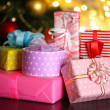 Many gifts on table on bright background — Stock Photo