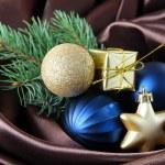 Beautiful Christmas decor on brown satin cloth — Stock Photo #34102753