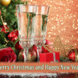 Composition with Christmas decorations and two champagne glasses, on bright background — Stock Photo #34108607
