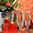Composition with Christmas decorations and two champagne glasses, on bright background — Stock Photo #34109171