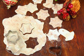 Making Christmas cookies on wooden table — Photo