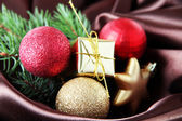 Beautiful Christmas decor on brown satin cloth — Stock Photo