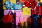 Many gifts on bright background — Stock Photo
