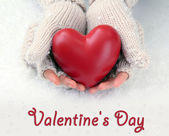 Female hands in mittens with red heart, close-up — Stock Photo