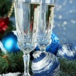Composition with Christmas decorations and two champagne glasses, on bright background — Stock Photo #34110091