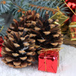Christmas decoration with pine cones on wooden background — Stock fotografie #34111573