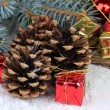 Christmas decoration with pine cones on wooden background — Stok fotoğraf #34111573