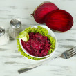 Beet salad in bowls on wooden table — Stock Photo