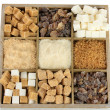 Stock Photo: Different types of sugar in wooden box isolated on white