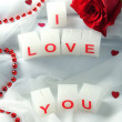 Candles with printed sign I LOVE YOU,on white fabric background — Lizenzfreies Foto
