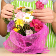 Florist makes flowers bouquet — Stock Photo #34112467