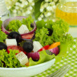 Greek salad on plate close-up — Stock Photo