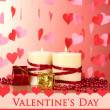 Stock Photo: Beautiful candles with romantic decor on a wooden table on a red background