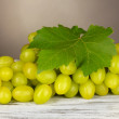 Ripe delicious grapes on table on gray background — Stockfoto