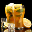 Iced tea with lemon and mint on black background — Стоковая фотография
