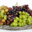 Fresh grape on wicker mat isolated on white — Stock Photo #34113269