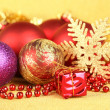 Christmas decorations on yellow background — Stock Photo #34113663