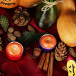 Table setting for Halloween with pumpkin and candles close-up — Stock Photo #34113915