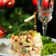 Russian traditional salad Olivier, on wooden table, on bright background — Stock Photo #34114459