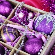 Christmas toys in wooden box close-up — Stock Photo #34115667