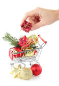 Hand and Christmas gifts — Stock Photo